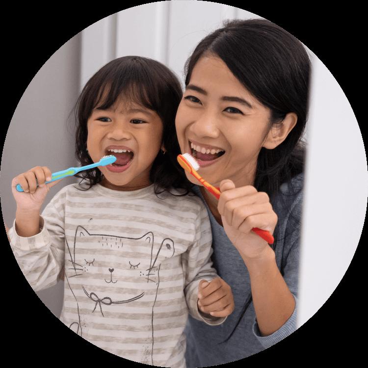 mom and kid brushing their teeth