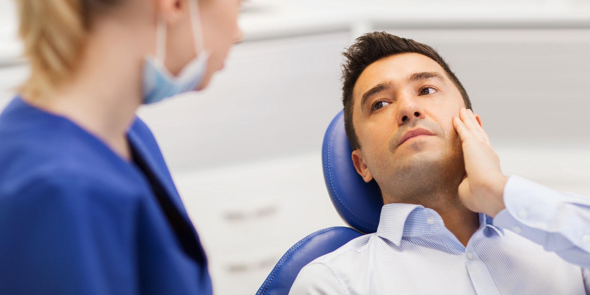Dental Patient holding cheek